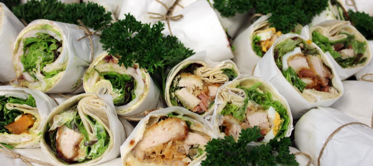 A platter of gourmet sandwich wraps