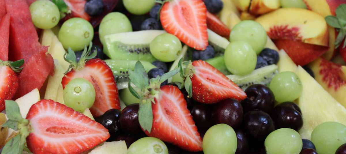 A platter of fresh cut fruit salad