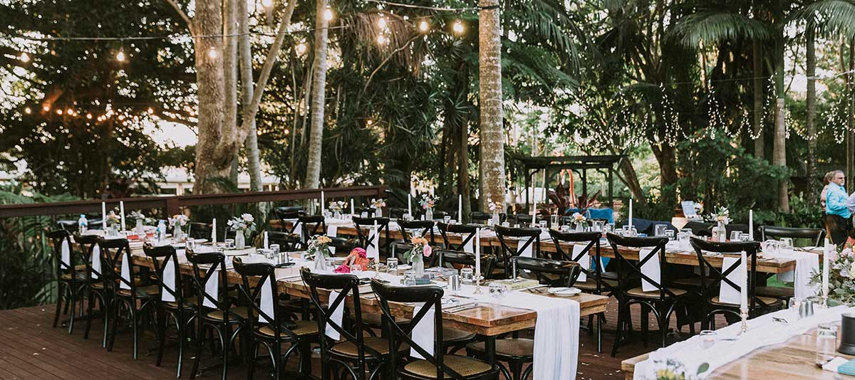 Wedding tables on the Figtree Deck at Summerland Farm