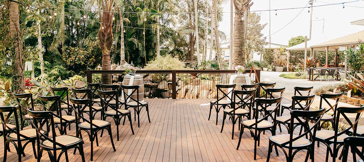 Chairs arranged for a wedding on the Waterfall Deck wedding venue at Summerland Farm