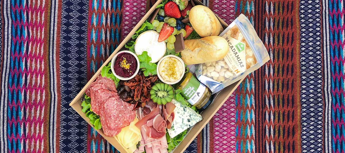 Colourful gourmet foods in a picnic box at Summerland Farm